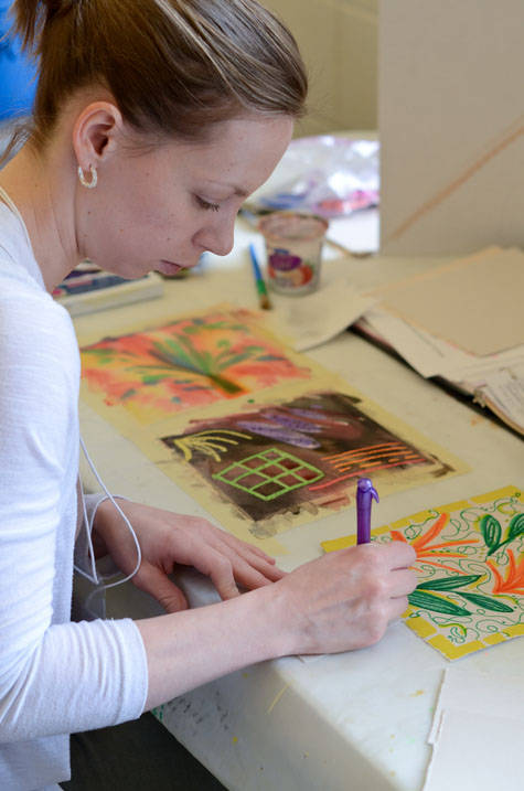 Student adds finishing touches to art therapy project