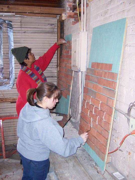Students working on historic preservation brick restoration