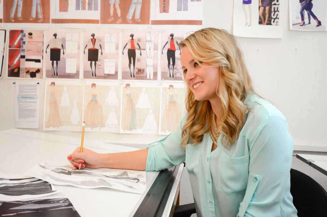 Fashion merchandising degree student working on sketches