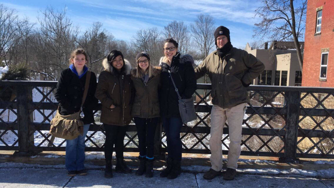 Students and professor on bridge in Chagrin Falls