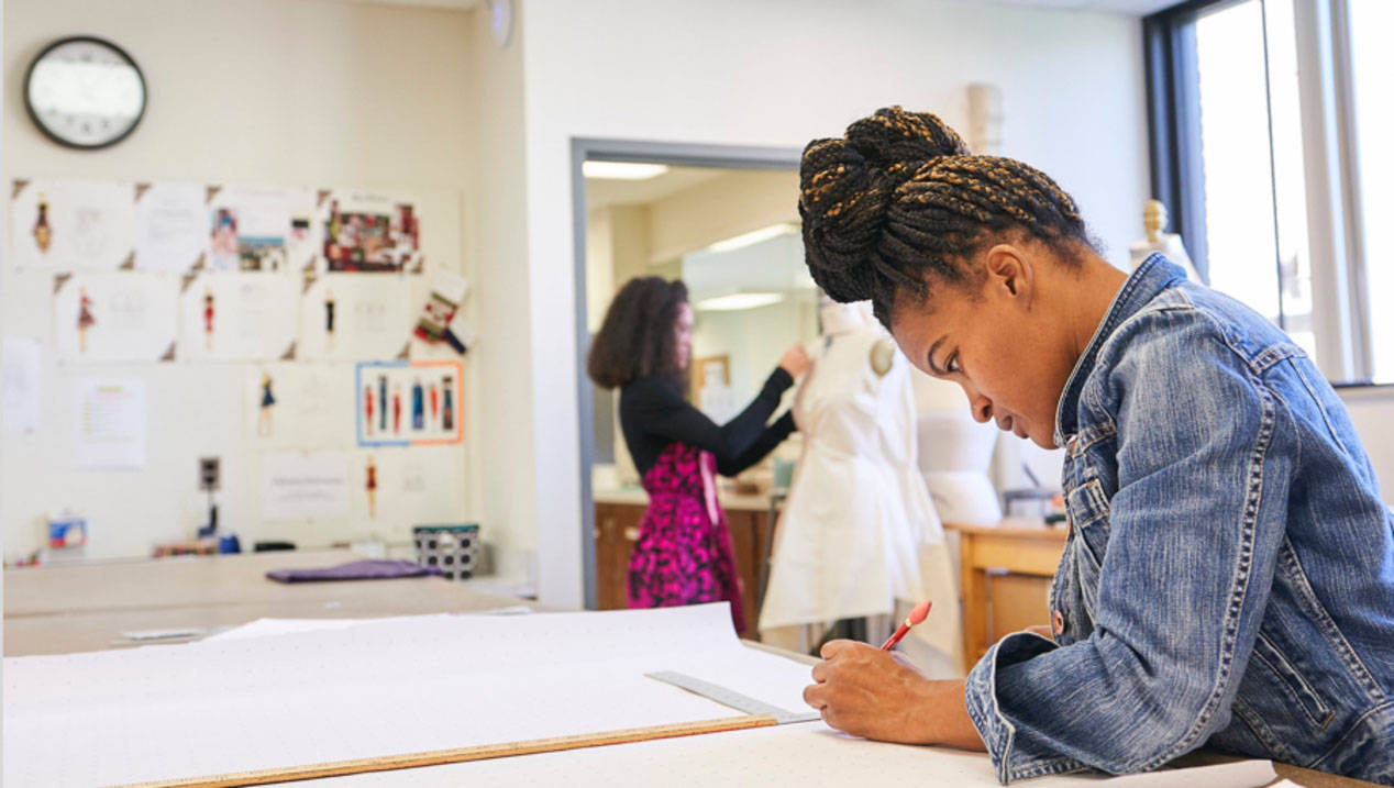 A Fashion Design student works on a project at Ursuline College