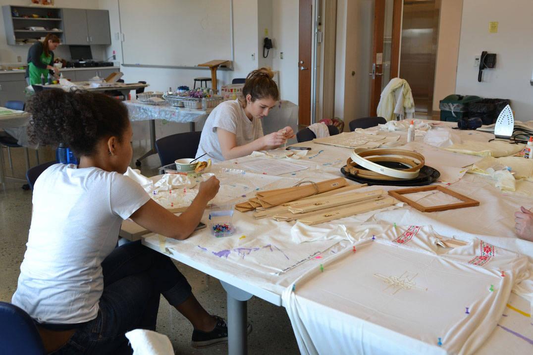 Ursuline art therapy program students creating textile designs in studio