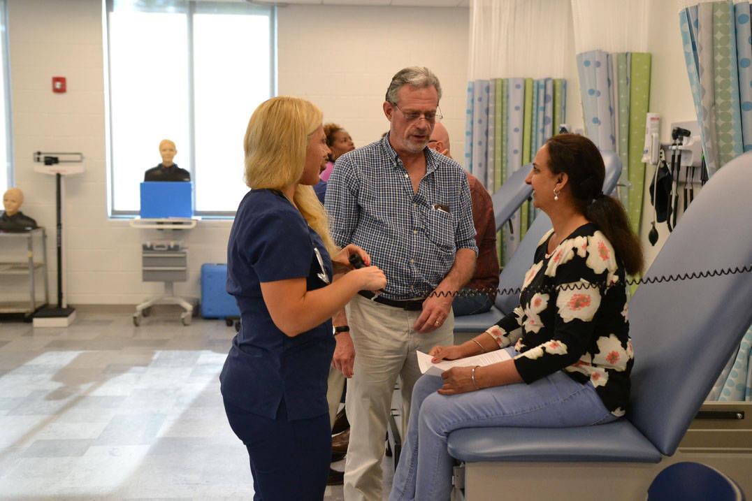 Nursing professor instructs students in lab