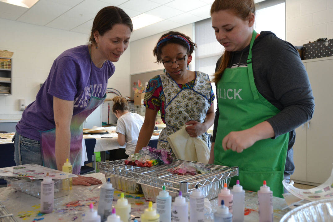 Art therapy degree professor working with students in studio