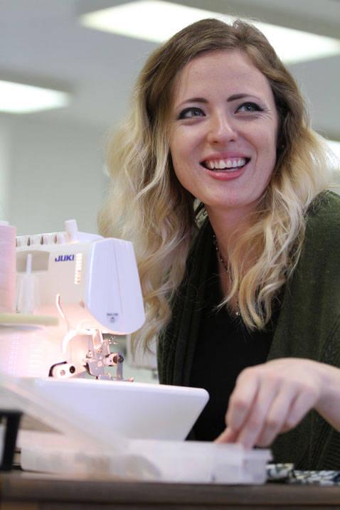 Fashion design student using sewing machine