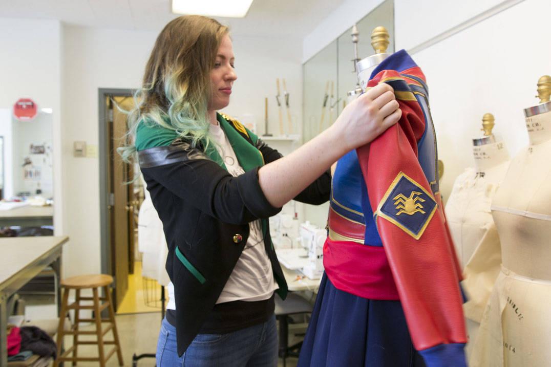 Fashion design student working on custom leather costume