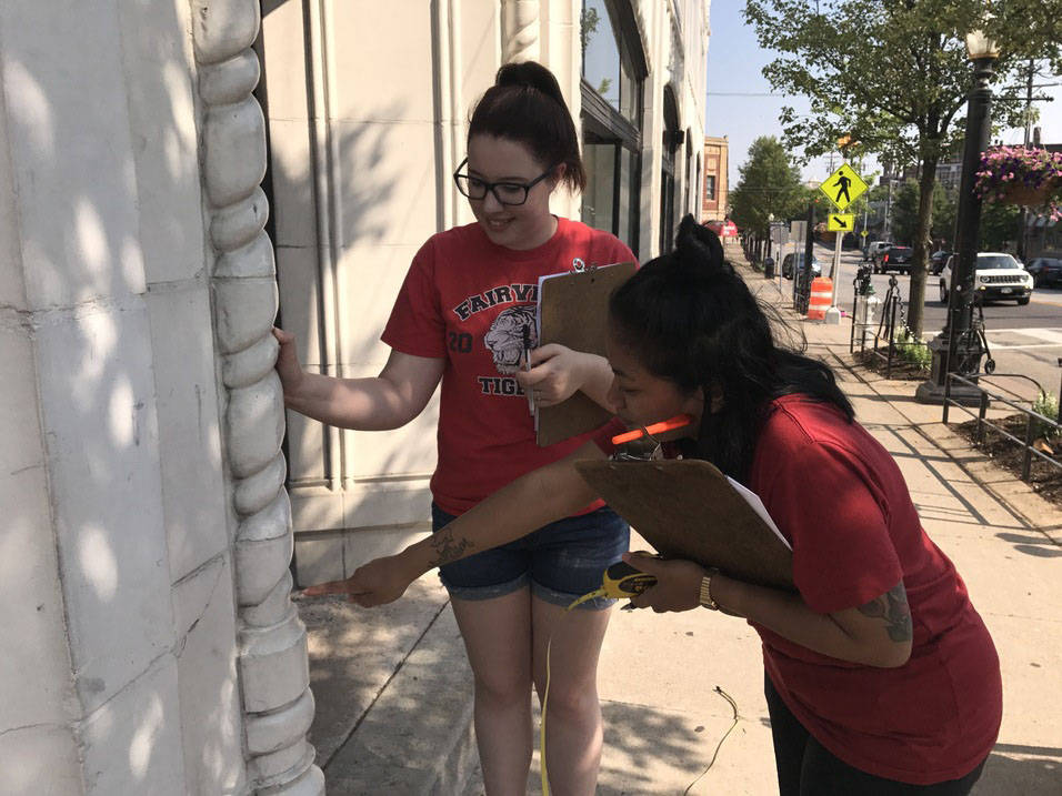 Students examine architectural elements of building