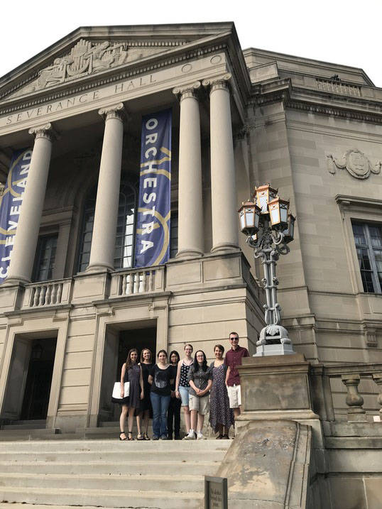 Students pose together outside of Severence Hall, where the Cleveland Orchestra performs.
