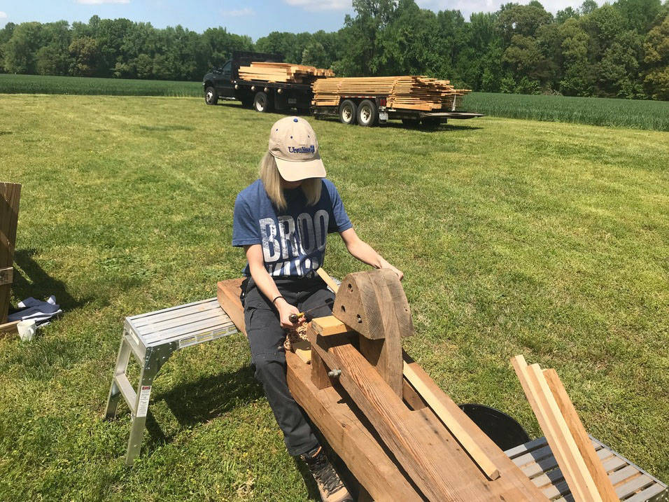 Student works on building project during summer internship