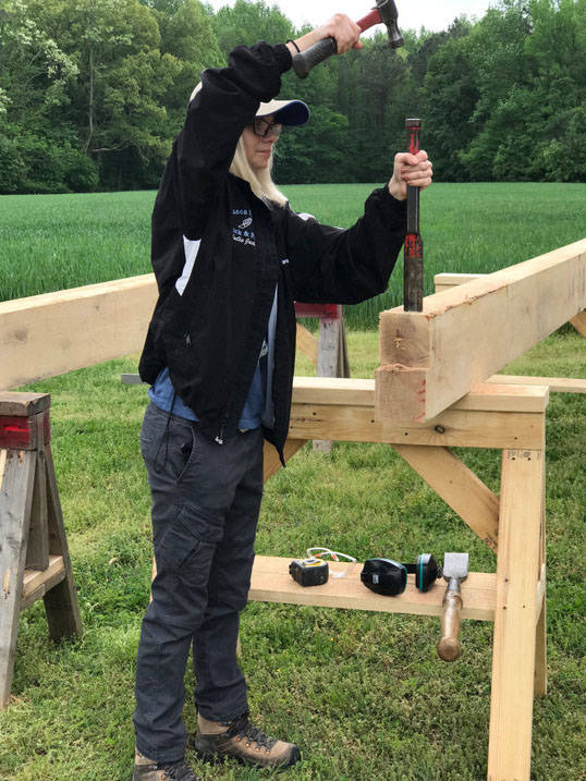 Graduate students works on construction during internship