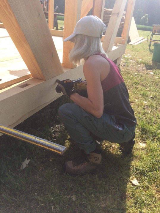 Student works on construction during summer internship