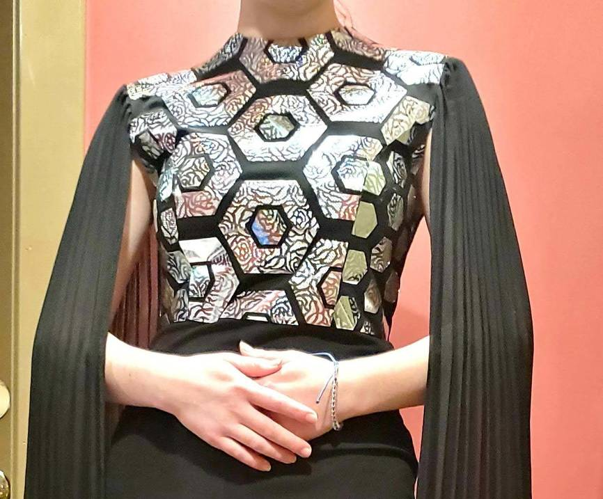 Student wears garment she made