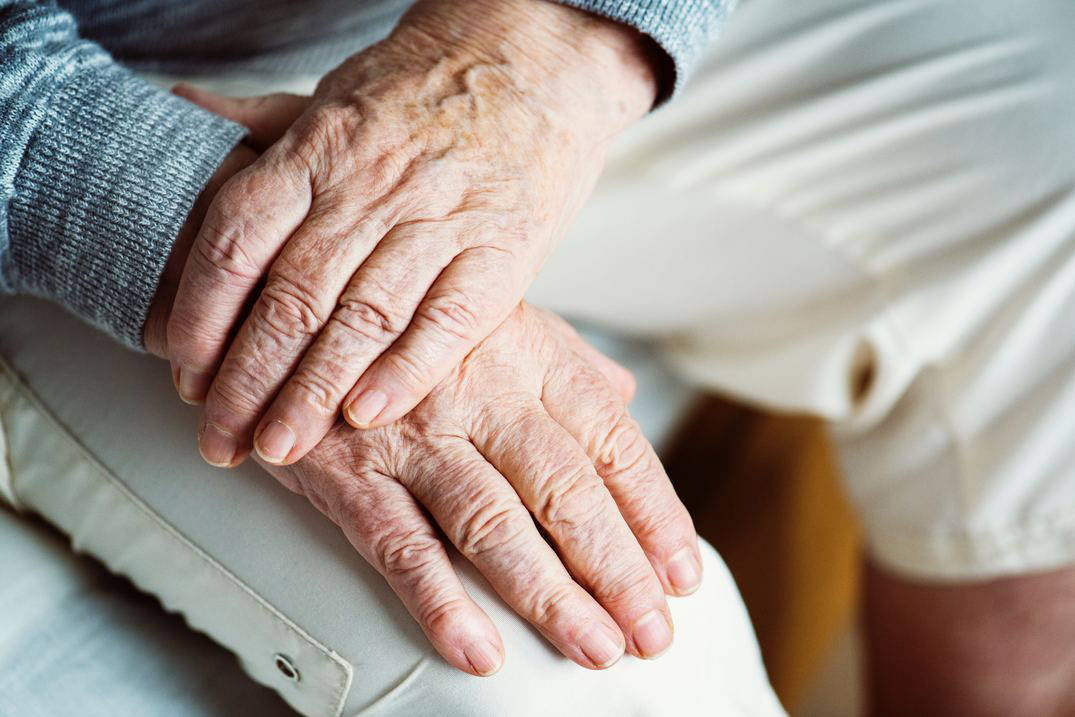Senior patient's hands at appointment with adult gerontology acute care nurse practitioner in Ohio