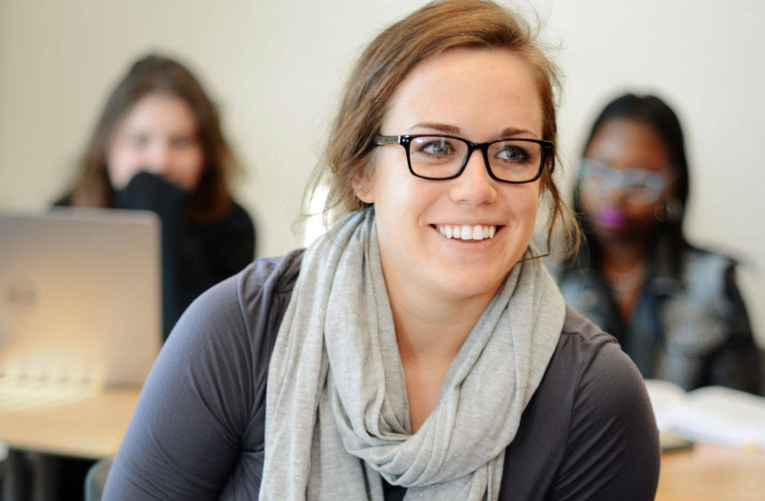 Accelerated psychology degree student smiling in class
