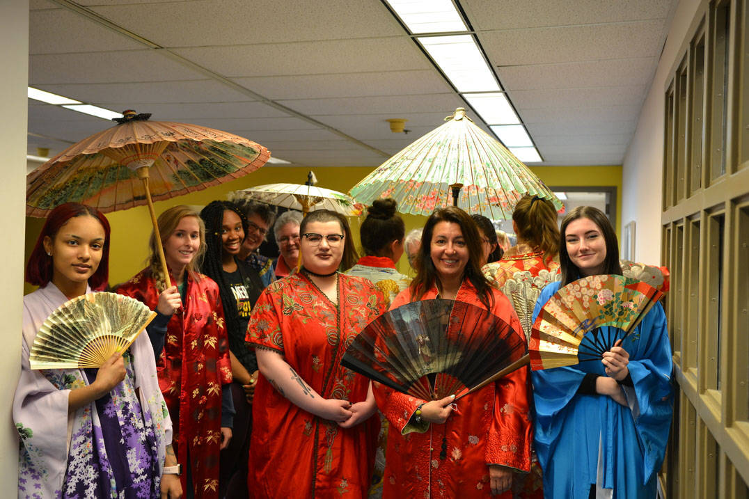 Fashion design students pose in Historic Costume Study Collection dresses
