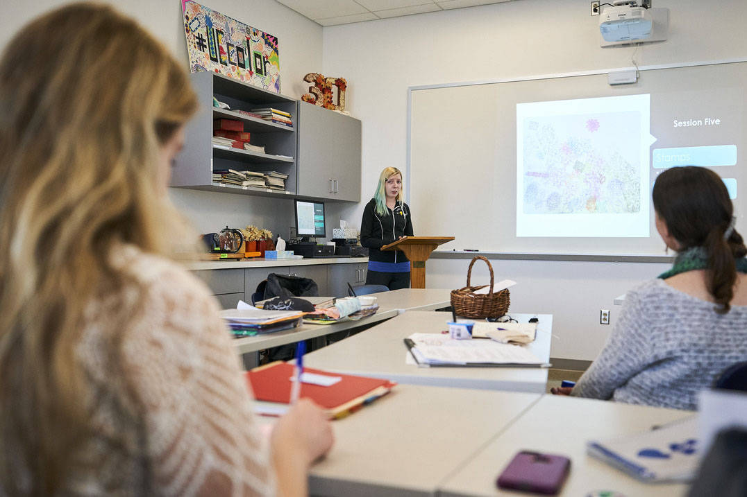 Art therapy program student presenting in classroom