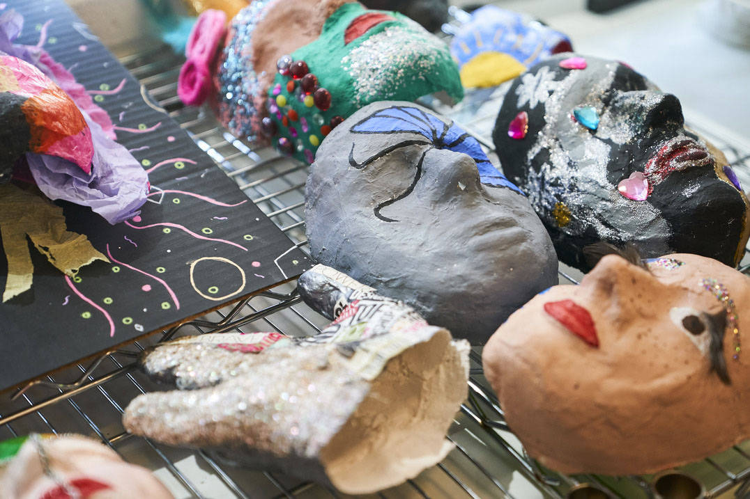 Masks made by Ursuline art therapy degree students