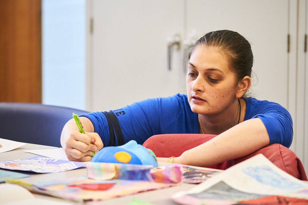 Art therapy program student writing critique