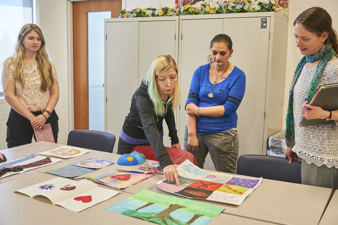 Art therapy degree student giving peer feedback
