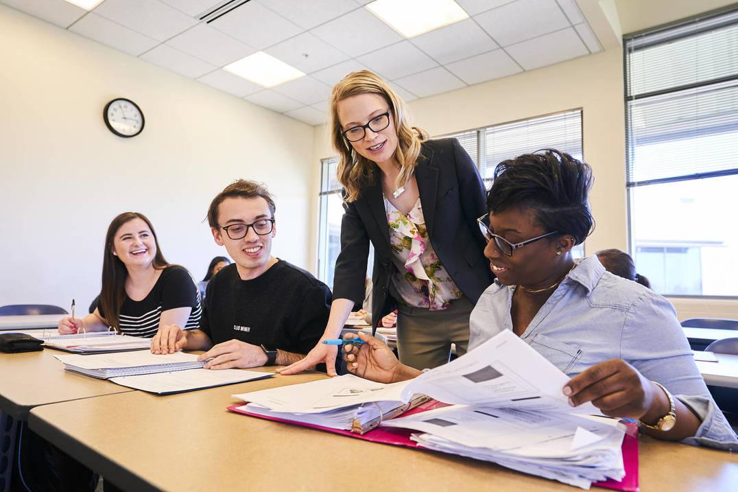 Nursing students learn from professor in class