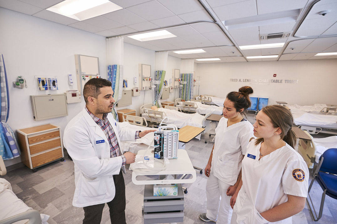 Professor explains breathing machine to accelerated nursing students in Ohio