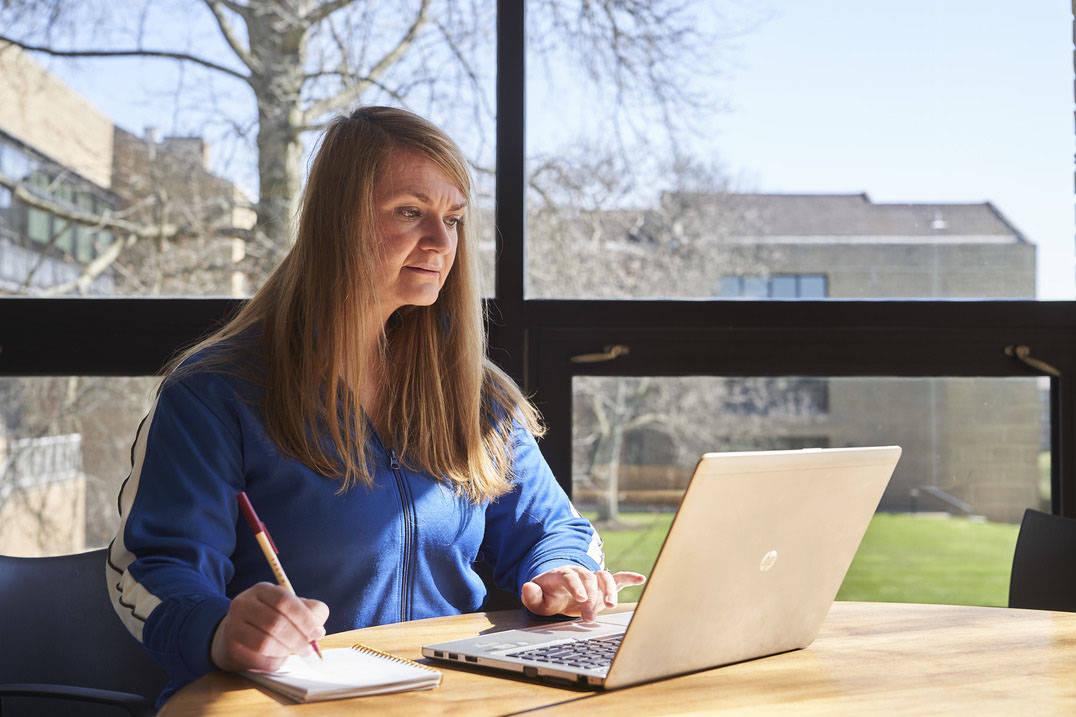 Online bachelor's in social work student using laptop