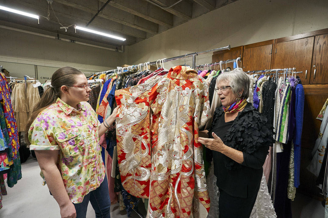 Fashion design professor talks with student about historic pieces