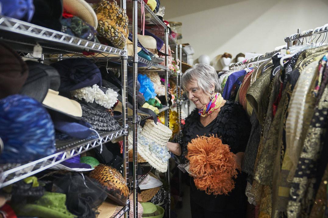 Fashion design degree professor looking at Historic Costume Study hats