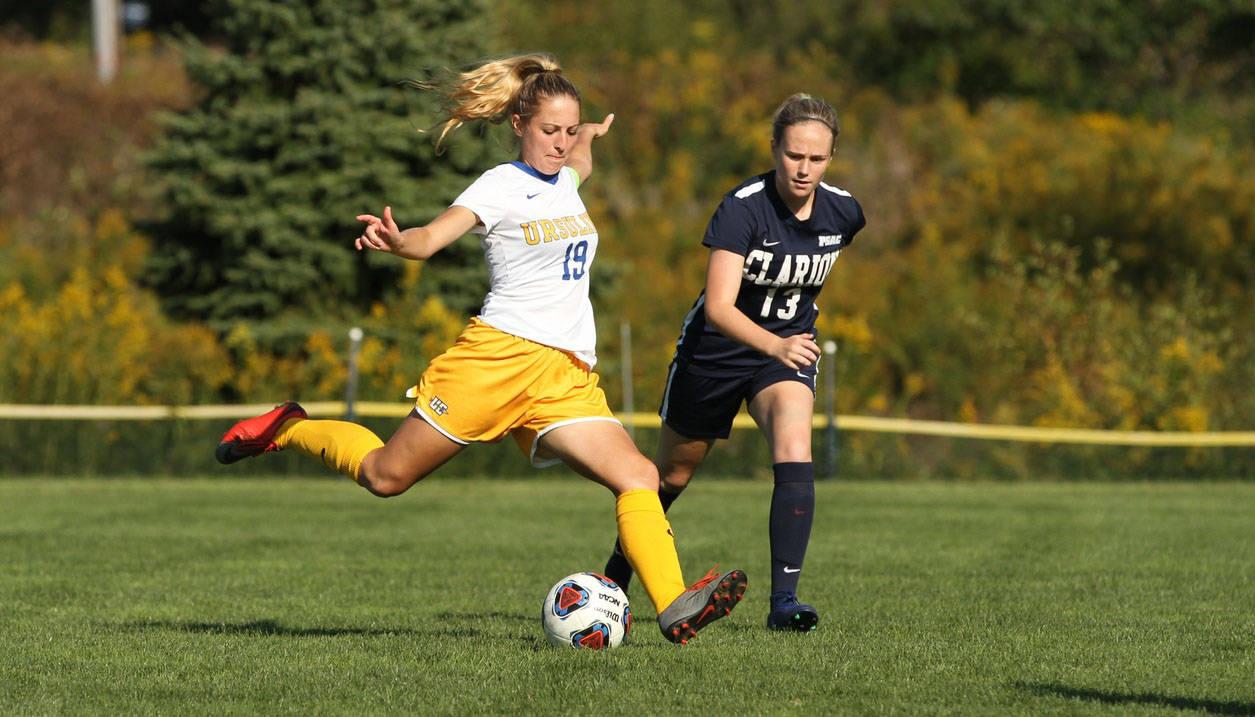 Ursuline College soccer player kicking